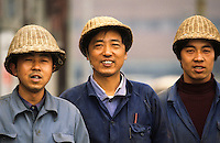 China. Provincial mine workers, wearing basket weave hard hats.