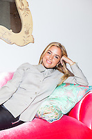 Interior designer Sasha Bikoff at her new store in Tribeca on a vintage deco &quot;croissant&quot; sofa upholstered in pink velvet. <br /> <br /> <br /> Danny Ghitis for The New York Times