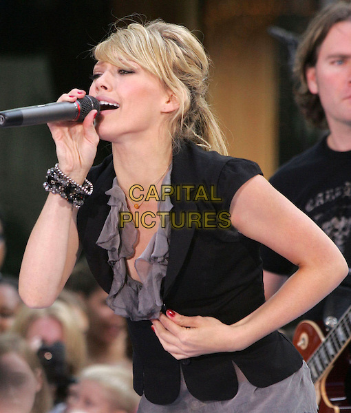 HILARY DUFF.Performs at the 'Today' Show Summer Concert Series,.NBC Studios, Rockefeller Plaza,.New York, 18th August 2005.half length stage music gig singer singing grey gray ruffle neck top chiffon black small fitted jacket bead bracelet red nail polish varnish microphone hair up messy fringe.www.capitalpictures.com.sales@capitalpictures.com.© Capital Pictures.