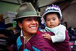 Quechuan Mother & Baby_Shopping For Hats At The Saquisili Market In Ecuador.