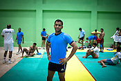 30 year old Srinivas Reddy, member of the Indian Kabbadi team poses for a portrait at a month long camp in Sport Authority of India Sports Complex in Bisankhedi, outskirts of Bhopal, Madhya Pradesh, India.