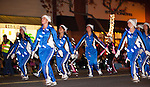 Dancers make their way down the street during the Festival of Lights PArade.
