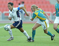 17 August 2004:    Julie Foudy dribbles the ball away from Sacha Wainwright at Kaftanzoglio Stadium in Thessaloniki, Greece.     USA tied Australia at 1-1.   Credit: Michael Pimentel / ISI