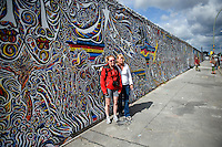 Tourists at the East Side Gallery, site of the former Berlin Wall that separated East Germany from West Germany.