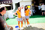 Mitch Carpenter, of Tennessee, poses with Hooters employees for a snapshot taken by a friend after spending the day on the course of The Augusta National Golf Club on the second practice day of the Augusta, Georgia tournament, April 6, 2010.