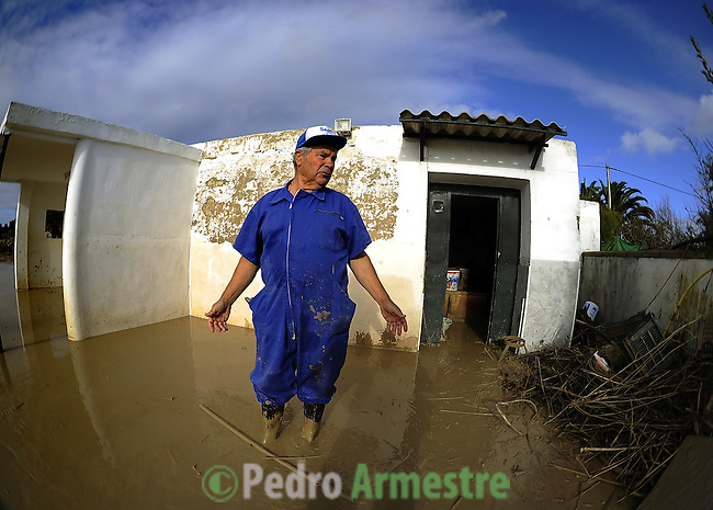 Cristobal Delgado is seen in his flooded home in the Pachecas, near Jerez de la Frontera in Cadiz is pictured after it was closed on january 05, 2010 for the heavy rain. (c)Pedro ARMESTRE.