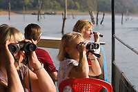 20080131_Periyar, India_ Tourists in a boat, observe a group of herbavores, including elephants, Sambar deer and Gaur also known as Indian bison in the Periyar Lake, which is located in the Periyar Wildlife Sancuary in the Southern Indian state of Kerala.  Photographer: Daniel J. Groshong/Tayo Photo Group