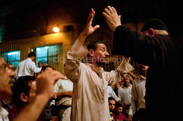 Mixed amongst other devoted Copts, this Muslim receives an exorcism in St. Simeon church in Mokattam.<br />