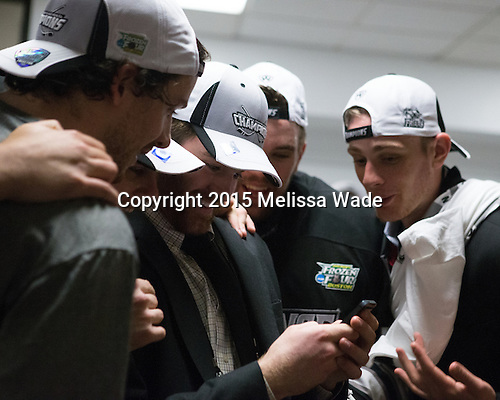 Players check out the celebrations back in Providence. - The Providence College Friars celebrated their national championship win after the Frozen Four final at TD Garden on Saturday, April 11, 2015, in Boston, Massachusetts.