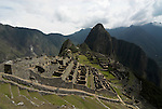Machu Picchu Inca Ruins, view looking down onto ruins, Mount Huayna Picchu in background, Sacred Urubamba Valley, Andes, Peru, sacred, temple, andean, mountain. .South America....