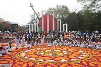 Bangladeshi girls decorates the Dhaka Central Shaheed Minar, or Martyr's Monuments on International Mother Language Day in Dhaka, Bangladesh, Saterday, Feb. 21, 2015.