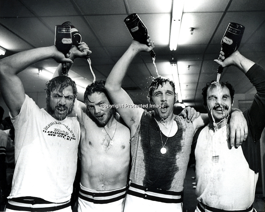 Oakland Athletics celebrate in Cincinnati after beating the Reds in the 7th game of the 1972 World Series. Pouring champagne over their heads from the left are: Mike Epstein, catcher Dave Duncan, left fielder Joe Rudi, and third baseman and captain Sal Bando.