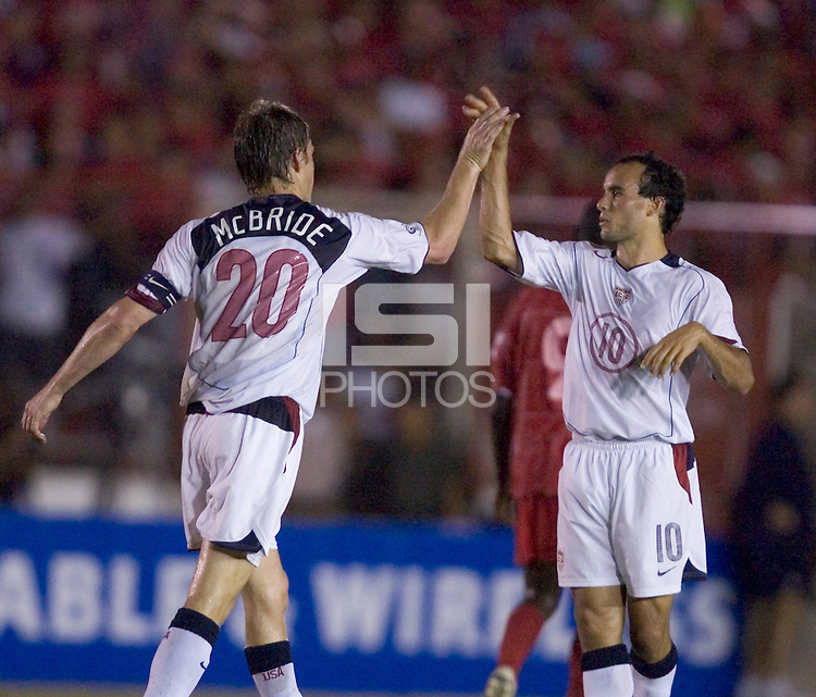 USA captain Brian McBride and Landon Donovan high five as the USA defeated Panama 3-0 in final round World Cup qualifying at Estadio Rommel Fernandez, Panama City, Panama, on June 8, 2005.