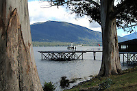 Helicopter on helipad jutting out unto Lake Te Anau, at Te Anau, South Island, New Zealand, 201004050042. Helicopter trips are a very popular way to see otherwise inaccessible landscapes,..Copyright Image from Victor Patterson, 54 Dorchester Park, Belfast, United Kingdom, UK. Tel: +44 28 90661296. Email: victorpatterson@me.com; Back-up: victorpatterson@gmail.com..For my Terms and Conditions of Use go to www.victorpatterson.com and click on the appropriate tab.