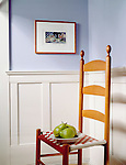 ladder back chair with oears and wainscoting