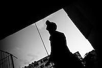 Jorge D., a Cuban hip-hop fan, walks out of the large apartment block of Alamar, a large public housing complex in the Eastern Havana, Cuba, 9 February 2009.