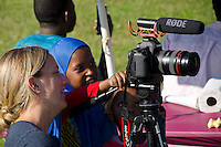 Colby instructor demonstrates filming to young Bantu woman, New Gloucester Maine, USA