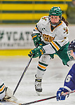 14 February 2015: University of Vermont Catamount Defender Rachael Ade, a Sophomore from Davenport, FL, in second period action against the University of New Hampshire Wildcats at Gutterson Fieldhouse in Burlington, Vermont. The Lady Catamounts rallied from a 3-1 deficit to earn a 3-3 tie in the final home game of their NCAA Hockey East season. Mandatory Credit: Ed Wolfstein Photo *** RAW (NEF) Image File Available ***