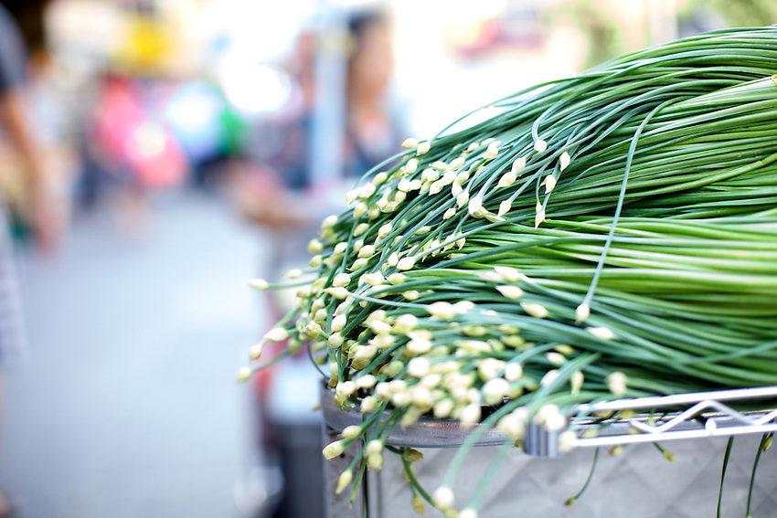 NEW YORK, NY - July 16, 2013: Garlic Chives on sale at a produce stand in Chinatown. CREDIT: Clay Williams for Serious Eats.<br /> <br /> &copy; Clay Williams / http://claywilliamsphoto.com
