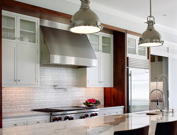 This custom kitchen features a Bamboo mosaic backsplash shown in Bardiglio and Calacatta Tia from New Ravenna.<br /> <br /> For pricing samples and design help, click here: http://www.newravenna.com/showrooms/