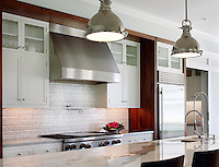 This custom kitchen features a Bamboo mosaic backsplash shown in Bardiglio and Calacatta Tia from New Ravenna.<br />