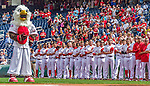 20 September 2015: Washington Nationals Mascot Screech and team stand in front of the dugout during the National Anthem prior to a game against the Miami Marlins at Nationals Park in Washington, DC. The Nationals defeated the Marlins 13-3 to take the final game of their 4-game series. Mandatory Credit: Ed Wolfstein Photo *** RAW (NEF) Image File Available ***