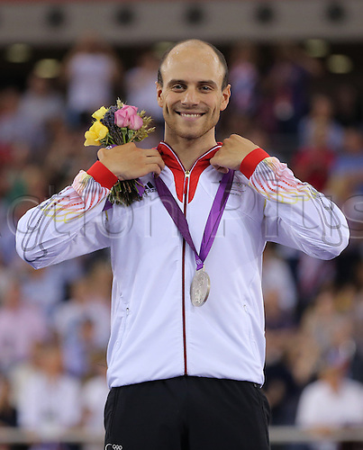07.08.2012. London, England. Silver medalist Maximilian Levy of Germany smiles after the Men's Keirin final race during the London 2012 Olympic Games Track Cycling competition, London, Britain, 07 August 2012.