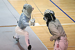 12 February 2017: Duke's Haley Fisher (left) and Boston College's Jackie Bai (right) during their Saber match. The Duke University Blue Devils hosted the Boston College Eagles at Card Gym in Durham, North Carolina in a 2017 College Women's Fencing match. Duke won the dual match 19-8 overall, 6-3 Foil, 5-4 Epee, and 8-1 Saber.