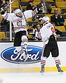 Mike McLaughlin (Northeastern - 18), Garrett Vermeersch (Northeastern - 9) and Peter Roby (Northeastern - AD) celebrate McLaughlin's game opening goal. - The Northeastern University Huskies defeated the Harvard University Crimson 4-0 in their Beanpot opener on Monday, February 7, 2011, at TD Garden in Boston, Massachusetts.