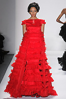 Model walks runway in a ruby silk organza princess ballgown w/pleated organza+tulle+ribbon fuffled borders, from the Zang Toi Fall 2012 &quot;Glamour At Gstaad&quot; collection, during Mercedes-Benz Fashion Week New York Fall 2012 at Lincoln Center.