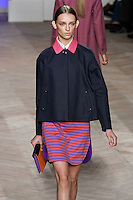 Daga Ziober walks the runway in a navy/pink cotton placket front jacket, and purple/orange cotton long-sleeved rugby shirtdress, by Tommy Hilfiger for the Tommy Hilfiger Spring 2012 Pop Prep Collection, during Mercedes-Benz Fashion Week Spring 2012.