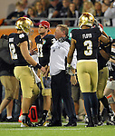 Head coach Brian Kelly talks with quarterback Andrew Hendrix (12).