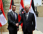 Palestinian Prime Minister Rami Hamdallah shakes hands with Austria's Chancellor Christian Kern in the West Bank city of Ramallah, on April 23, 2017. Photo by Prime Minister Office
