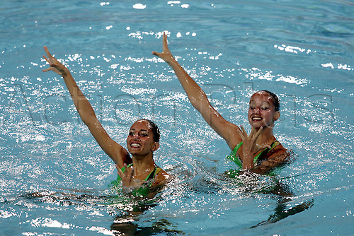 23 August 2004: The synchronised swimming duet of Beatrice Spaziani and Lorena Zaffalon from Italy (ITA) competing in the Technical Routine at the Olympic Aquatic Centre. 2004 Olympic Games, Athens, Greece. Photo: Neil Tingle/Action Plus..040823 olympics olympic sychronised swimming synchro-swimming synchro water sport water sports watersport watersports synchronized swimming swimmers teamwork routine women