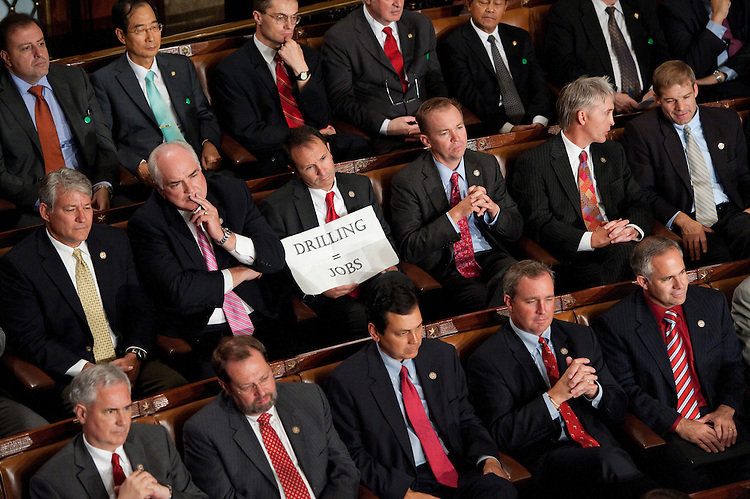 "UNITED STATES - SEPTEMBER 8: Rep. Jeff Landry, R-La., holds a sign which read ""drilling = jobs"" during President Barack Obama's speech on jobs to a joint session of Congress on Thursday, Sept. 8, 2011. (Photo By Bill Clark/Roll Call)"