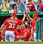 20 May 2012: Washington Nationals pitcher Stephen Strasburg returns to the dugout after hitting a home run - the first of his professional career - against the Baltimore Orioles at Nationals Park in Washington, DC. The Nationals defeated the Orioles 9-3 to salvage the third game of their 3-game series. Mandatory Credit: Ed Wolfstein Photo