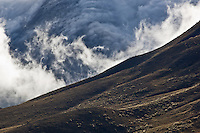 Clouds over mountains of Lindis Pass, New Zealand