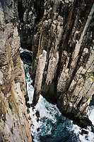 Dolerite columns and sea stacks, including the vertiginous totem pole, at Cape Hauy, Tasmania.
