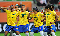 Marta (2nd right) of team Brazil celebrates with Rosana (l) , Cristiane (2nd left) and Maurine (r) during the FIFA Women's World Cup at the FIFA Stadium in Wolfsburg, Germany on July 3rd, 2011.