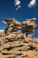 746000007 strange sandstone formations stand watch over the landscape in fantasy canyon a blm property in the middle of a working oil field in northeastern utah united states