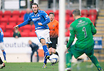 St Johnstone v Dundee United.....29.12.13   SPFL<br /> Stevie May fires the ball past Radoslaw Cierzniak to score his second goal<br /> Picture by Graeme Hart.<br /> Copyright Perthshire Picture Agency<br /> Tel: 01738 623350  Mobile: 07990 594431