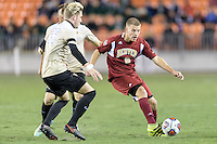 Houston, TX - Friday December 9, 2016: Blake Elder (6) of the Denver Pioneers passes the ball against the Wake Forest Demon Deacons at the NCAA Men's Soccer Semifinals at BBVA Compass Stadium in Houston Texas.