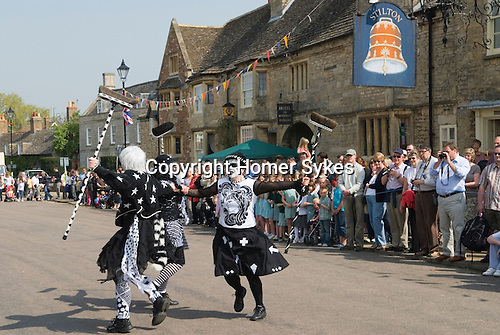 "Stilton village Cambridgeshire UK 2008. ""Pig Dykes Molly"" Morris Dancers performing a ""broom dance"""