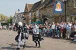 "Stilton village Cambridgeshire UK 2008. ""Pig Dykes Molly"" Morris Dancers performing a ""broom dance"""