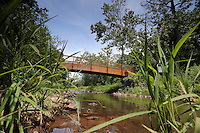 A bridge leads across Meadow creek along the Rivanna Trail in Charlottesville, Va. Photo/Andrew Shurtleff