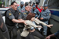 Moscow, Russia, 27/05/2012..Police arrest a gay activist during clashes as Russian nationalists attacked gay rights activists during their seventh attempt to hold a gay pride parade in the Russian capital.