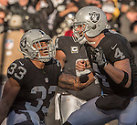 Oakland Raiders running back DeAndre Washington (33) celebrates touchdown with quarterback Derek Carr (4) on Saturday, December 24, 2016, at O.co Coliseum in Oakland, California.  The Raiders defeated the Colts 33-25.