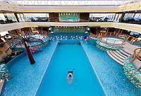 Water upon water. Where much of the developing world has no access to clean drinking water there is an endless array of water-based recreation in the west. A solitary man swims in the pool aboard a European cruise ship, one of a dozen pools and Jacuzzis aboard ship, while sailing across the Mediterranean Ocean.