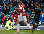 Ref John Beaton watches as Wes Foderingham twists his body around to shield the ball whicj is outside the box as he collects it