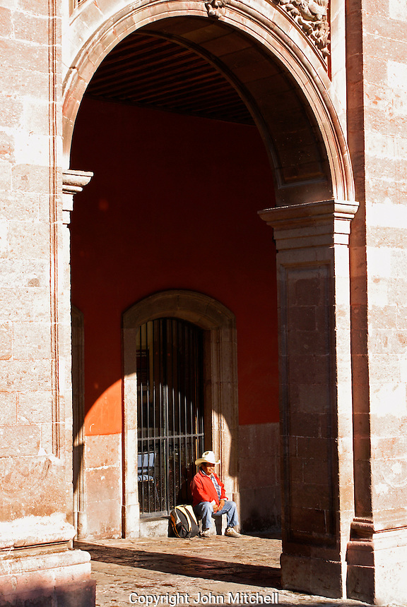 Mexican man sitting under the portales or arches in San Miguel de Allende, Mexico